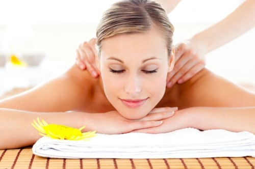 smiling-peaceful-woman-getting-back-massage