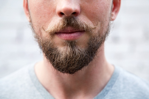Close up man 's face with a beard and mustache