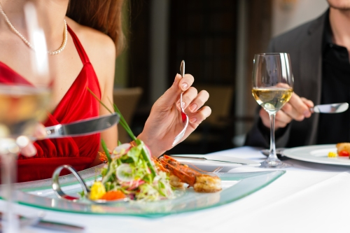 Couple for romantic Dinner or lunch in a gourmet restaurant drin