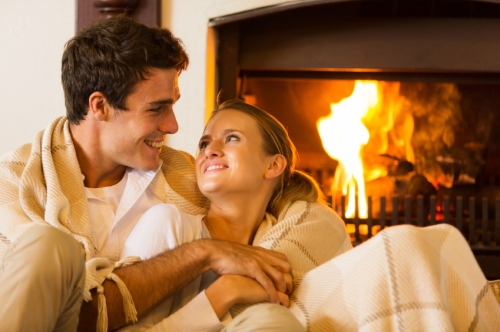 couple spend romantic evening by th fireplace