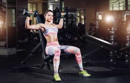 gym-woman-sexy-dumbbells-pose